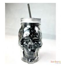Crâne en verre et Dragibus noirs